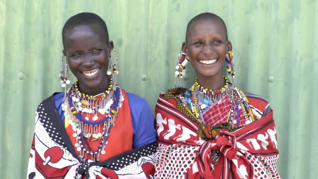 smiling maasai tribal women. kenya, africa. - etnia video stock e b–roll
