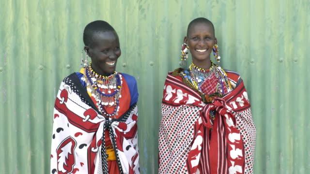 smiling maasai tribal women. kenya, africa. - 先住民文化点の映像素材/bロール