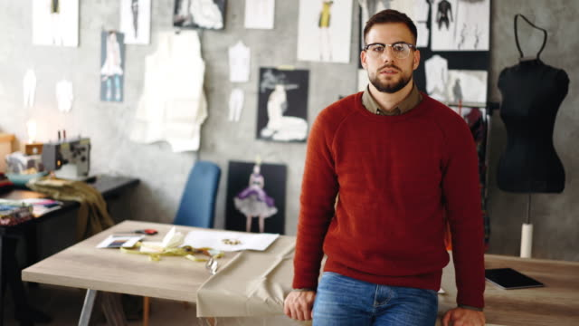 smiling male fashion designer with eyeglasses - atelier fashion stock videos & royalty-free footage