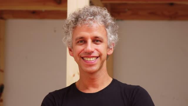 smiling man at pot making studio - grey hair stock videos & royalty-free footage