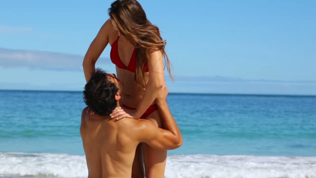smiling man catching his girlfriend - swimwear stock videos & royalty-free footage