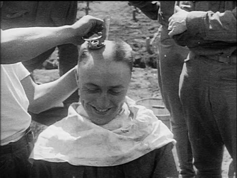 b/w 1917 smiling man getting head shaved at military training camp / ww i / documentary - shaving stock videos & royalty-free footage