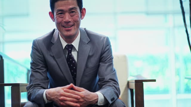 smiling man in suit - only japanese stock videos & royalty-free footage