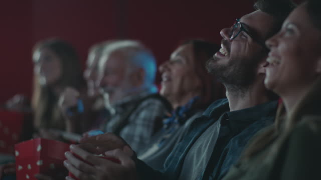 smiling man watching movie at cinema - theatre building stock videos & royalty-free footage