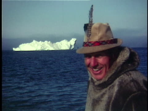 1980 cu smiling man wearing hat with feather on boat, glacier in background, greenland - home movie stock videos & royalty-free footage