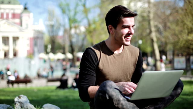 smiling man with laptop outdoors - bulgaria stock videos & royalty-free footage