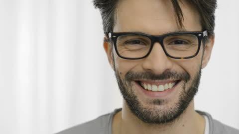 stockvideo's en b-roll-footage met smiling man with specs - bril brillen en lenzen