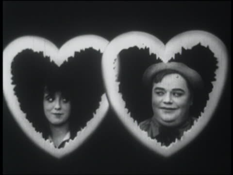b/w 1916 smiling man + woman framed by hearts - fatty arbuckle stock videos and b-roll footage