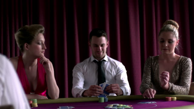 smiling man won against two girl - casino cards stock videos & royalty-free footage