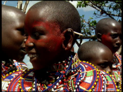 smiling masai girl with painted face wearing traditional jewellery africa - human face stock videos & royalty-free footage