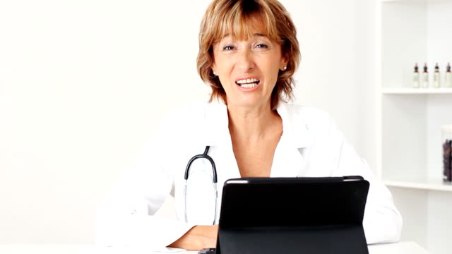 smiling mature female doctor - female doctor stock videos & royalty-free footage