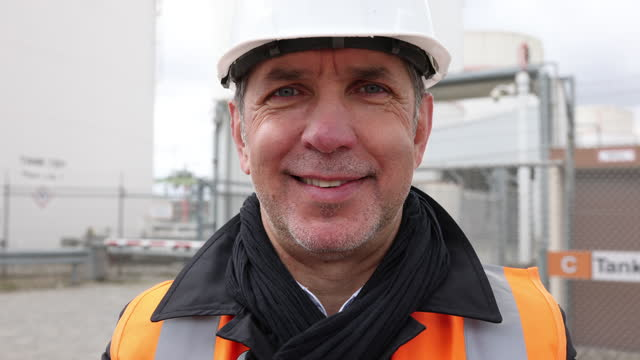 smiling mature male engineer at refinery - germany stock videos & royalty-free footage