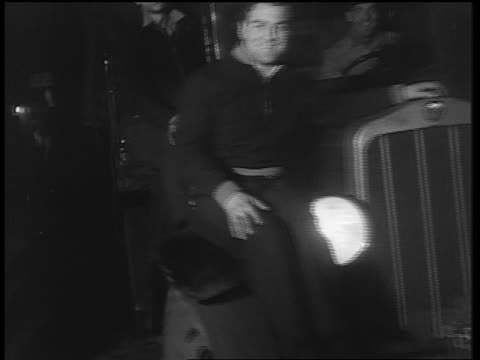 stockvideo's en b-roll-footage met smiling men sitting on truck slowly driving past camera / end of prohibition - 1933