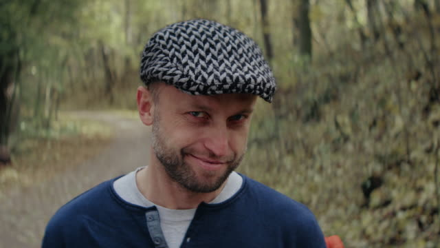 smiling men standing in forest - flat cap stock videos & royalty-free footage