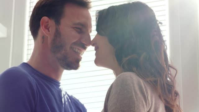 smiling mid adult couple rubbing noses together while having a romantic moment - mid adult couple stock videos & royalty-free footage