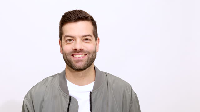 smiling mid adult man on white background - white background stock videos & royalty-free footage
