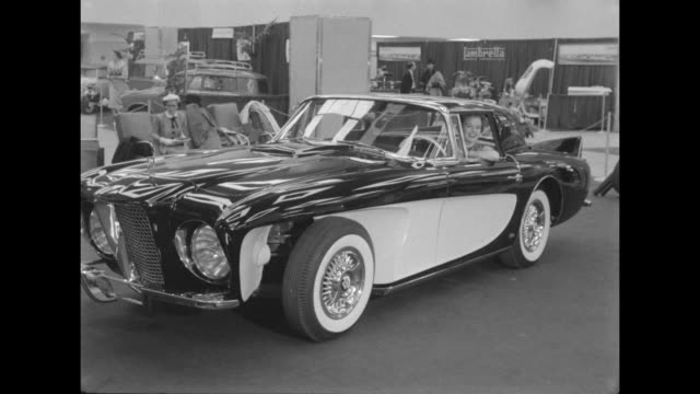 ws smiling model sits in car exhibited at the 1956 international automobile show / ws model waves from the same car with the convertible roof... - motor show stock videos and b-roll footage