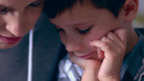 smiling mother and son learning to write numbers - pen stock videos & royalty-free footage