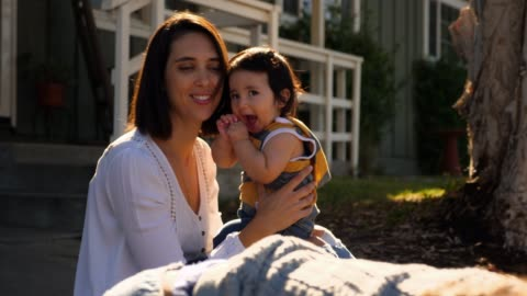 ms smiling mother holding infant son in front yard of home on summer morning - baby boys stock videos & royalty-free footage