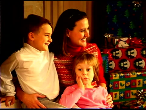 smiling mother with children during christmas - see other clips from this shoot 1407 stock videos and b-roll footage