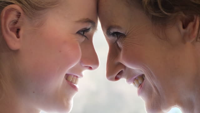 smiling mother with  daughter. close up of mother and daughter faces together - two generation family stock videos & royalty-free footage