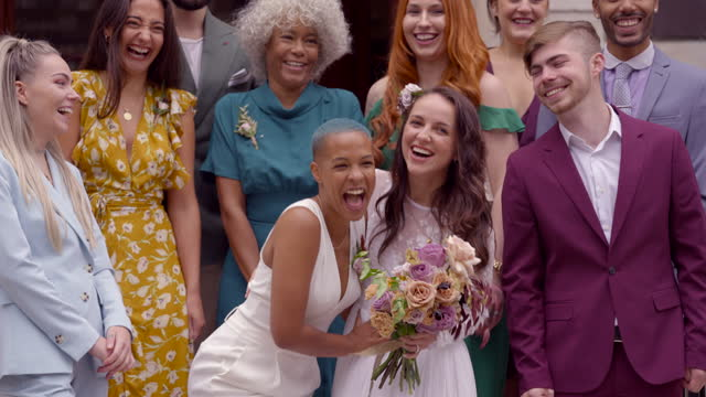 smiling newlywed lesbian couple celebrating their wedding - three quarter length stock videos & royalty-free footage