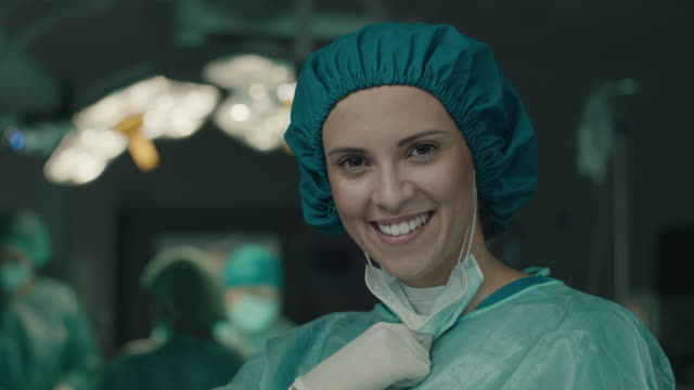 smiling nurse in operating room - female nurse stock videos & royalty-free footage