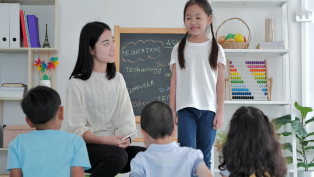 smiling of leadership asian little girl standing a presenting to elementary school class.friendship,leadership,education,children,success,volunteer,leadership,education,back to school concept - primary school child stock videos & royalty-free footage