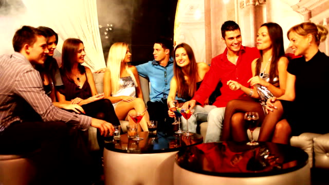 smiling people enjoying in communicate at night club. - party social event stock videos & royalty-free footage