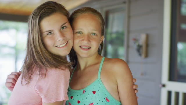 Smiling Portait of Two Young Girls