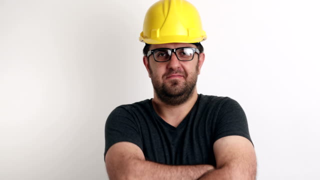 Smiling portrait of construction worker on white background