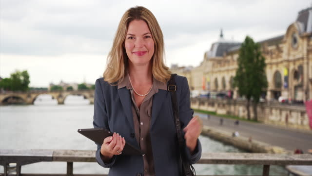 smiling portrait of paris businesswoman using touchpad - touchpad stock videos & royalty-free footage