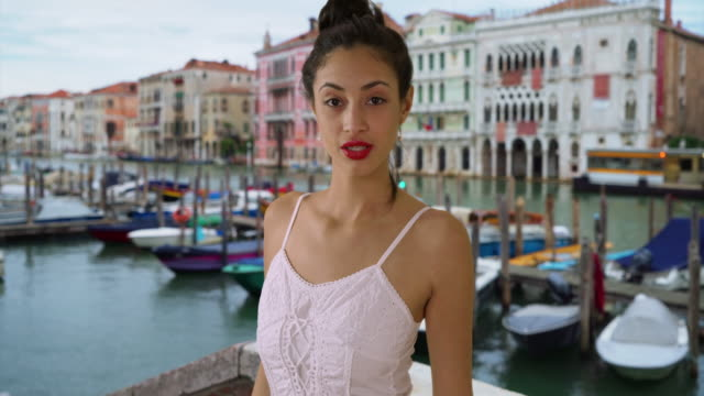 Smiling portrait of sultry Latina woman in white sundress near Grand Canal
