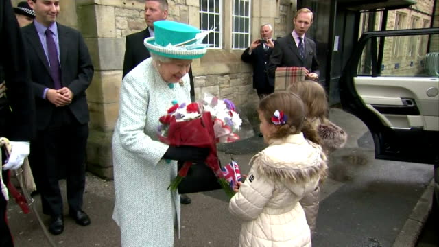 smiling queen elizabeth ii greeting various dignitaries and the mayor of lancaster and accepts bouquet of flowers from some little girls on may 29,... - ランカシャー点の映像素材/bロール