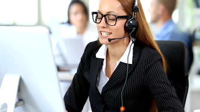 hd smiling redhead woman with headset and eyeglasses working in modern office - headset stock videos & royalty-free footage