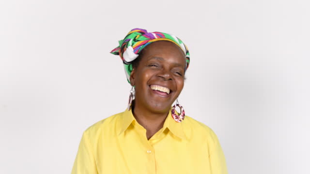 smiling retired senior woman with headscarf - white background stock videos & royalty-free footage