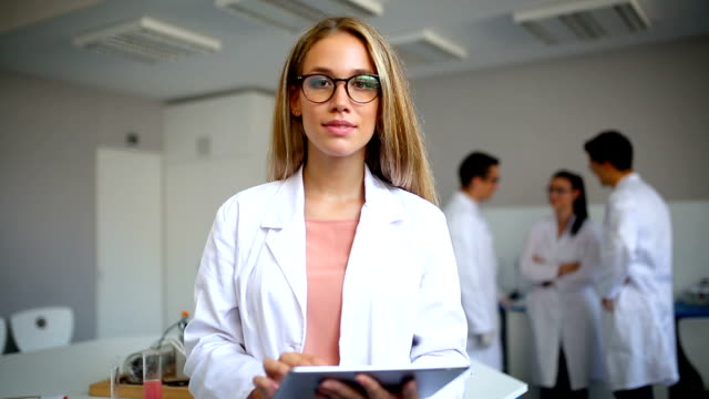 smiling scientist in laboratory - lab coat stock videos & royalty-free footage