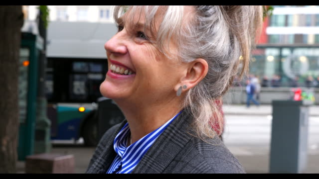 cu smiling senior businesswoman in discussion with colleagues during commute to work - 60 69 years stock videos & royalty-free footage