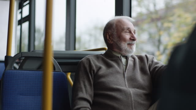 smiling senior man riding on a bus - on the move stock videos & royalty-free footage