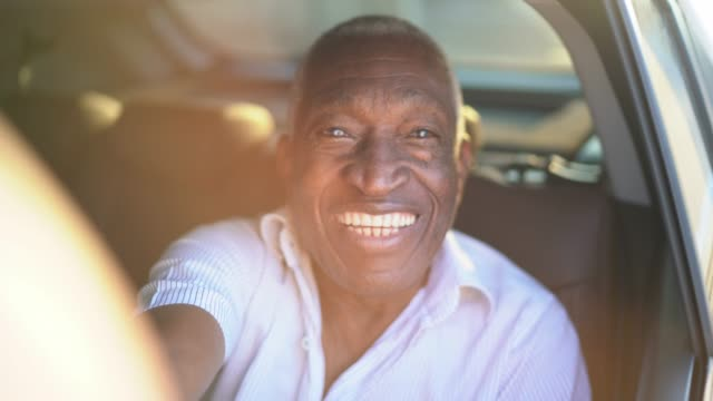 smiling senior man taking a selfie in the car - african american ethnicity stock videos & royalty-free footage