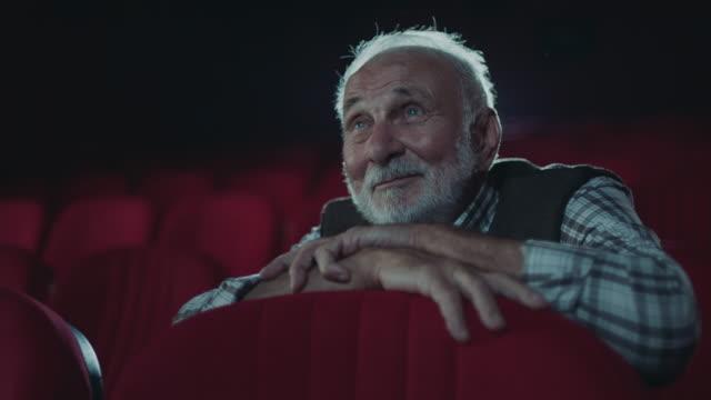 smiling senior men in cinema - auditorium stock videos & royalty-free footage