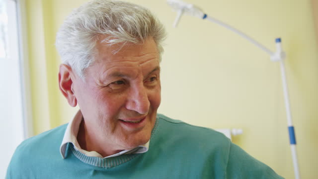 smiling senior patient looking away at clinic - medical examination room stock videos & royalty-free footage