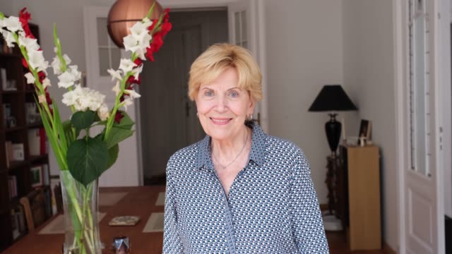 smiling senior woman inside her home - styles stock videos & royalty-free footage