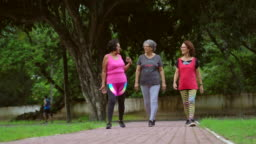 Smiling seniors women jogging in the park