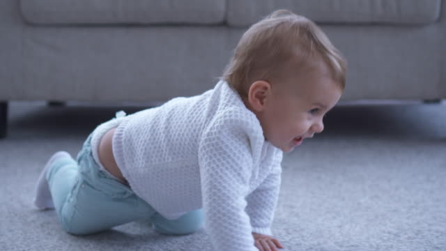 smiling small girl crawling on the floor - crawling stock videos & royalty-free footage