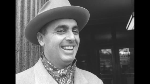 cu smiling stephen a mitchell chair of the democratic national committee stands outside building wearing hat overcoat and paisley neck scarf / he... - leitende person stock-videos und b-roll-filmmaterial