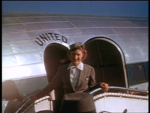 1941 smiling stewardess posing in front of united airlines airplane / san francisco / industrial - crew stock videos & royalty-free footage