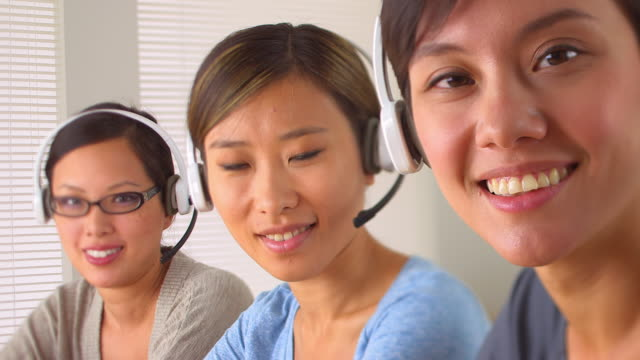 Smiling telemarketers