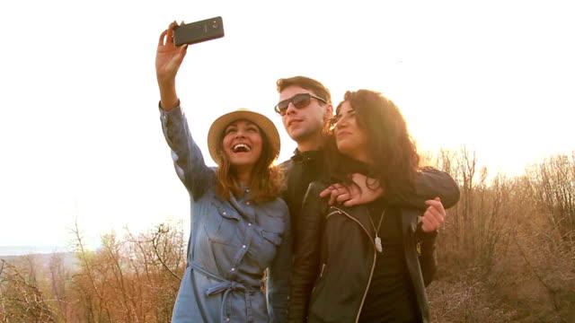 Smiling three friends seducing the camera