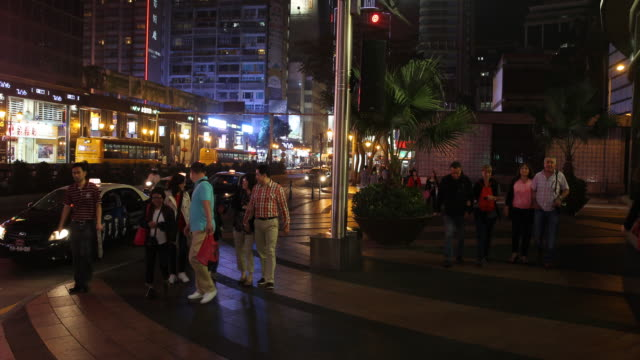 smiling tourists walking down the busy avenida de lisboa in macau tourism and gambling are the primary drivers of macau's economy - avenida stock videos & royalty-free footage